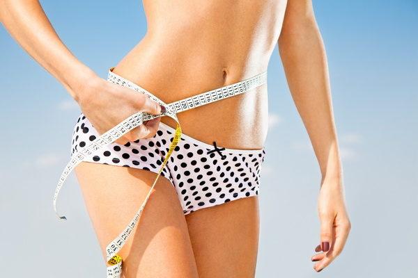 woman-measuring-perfect-shape-of-beautiful-hips